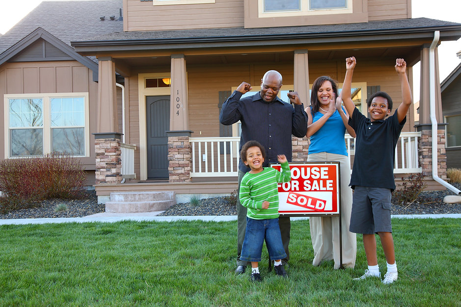 African American family celebrates new h