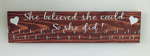 She believed she could! Indian Rosewood stain medal hanger 25 hook