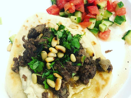 Hummus topped with Ground Beef, and Flat Bread