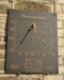 Bronze wall sundial