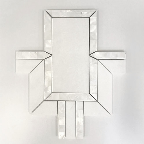 A combination of iridescent mother of pearl and bianco thassos marble make this geometric pattern unique and refined
