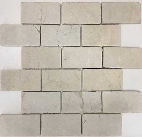 "Crema marfil tumbled subway tile in 2""x4"""