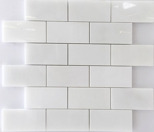 Glacier white marble subway tile is made up of varying shades white.