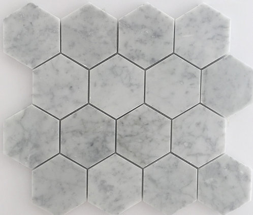 Bianco Carrara Italian polished marble cut into hexagons is trending and beautiful installed in your home