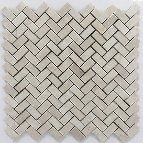 Polished Botticino Italian marble in a herringbone mosaic pattern.  Great for a kitchen backsplash