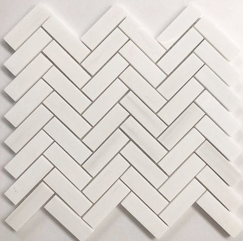 "Dolomite marble stone tile polished and in a herringbone 1""x3"" pattern"