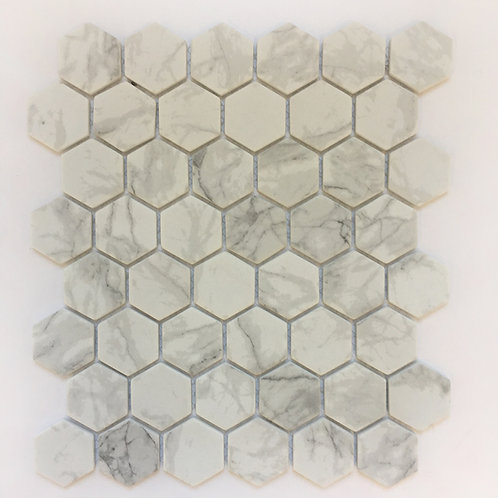 Enamel Hexagon Carrara is a mosaic tile that looks like bianco carrara marble but that does not require the maintenance