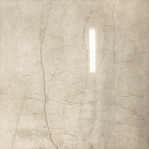 Bello Excess Savanna, is a big, polished porcelain tile with warm tones and colors that create an inviting space