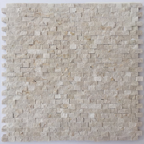 Crema Marfil splitface marble mosaic in a brick joint pattern