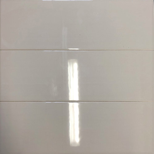A large subway tile in a warm taupe colour with a high gloss ceramic finish. Ideal for all wall designs.