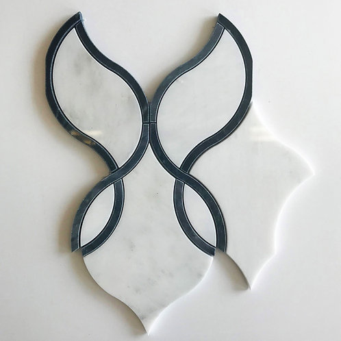 This Black and white tile is made out of polished marble that has been cut by water jet.  It elevates interior design.
