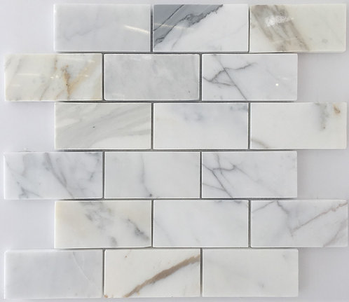 Calacatta stone tile subway tile with lovely golds, browns and greys - a classic italian marble