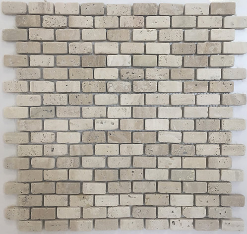 Mosaic brick joint in Travertine chiaro a classic tile for a kitchen backsplash or fire place surround