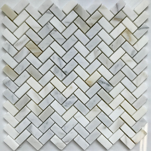 Calacatta herringbone mosaic in a polished finish is the perfect little tile to dress up your powder room or master bathroom