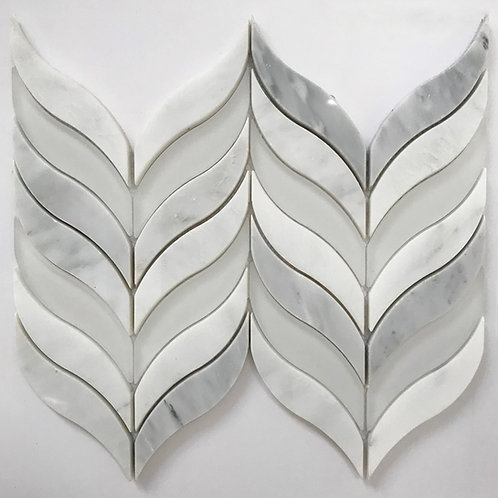 white glass tile combines with carrara marble tile to create this organic feather like pattern