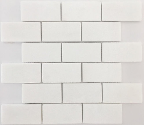Bianco Thassos a white marble that is an elevated subway tile. perfect for bathrooms, kitchens and decorative borders