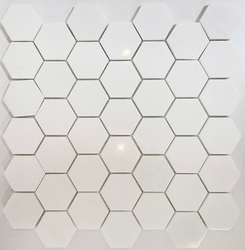 "Crisp white bianco thassos marble 2""hexagons in a polished finish."