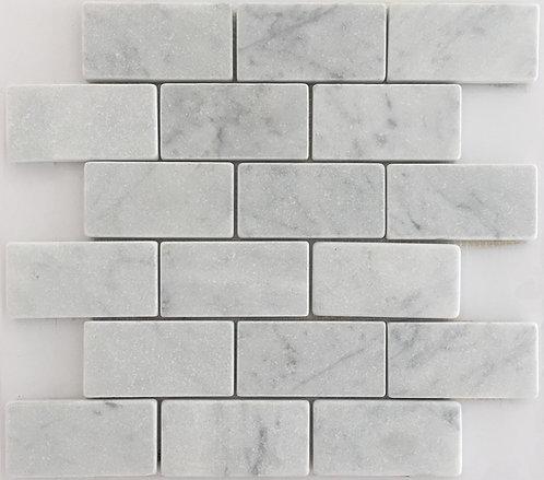Italian marble bianco carrara in a subway tile shape with a soft tumbled finish
