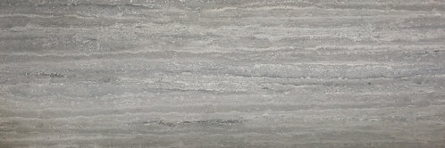 Big porcelain tile that looks like silver travertine in a honed finish.  Stunning and realistic.