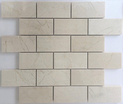 Crema marfil 2x4 subway tile in a polished marble