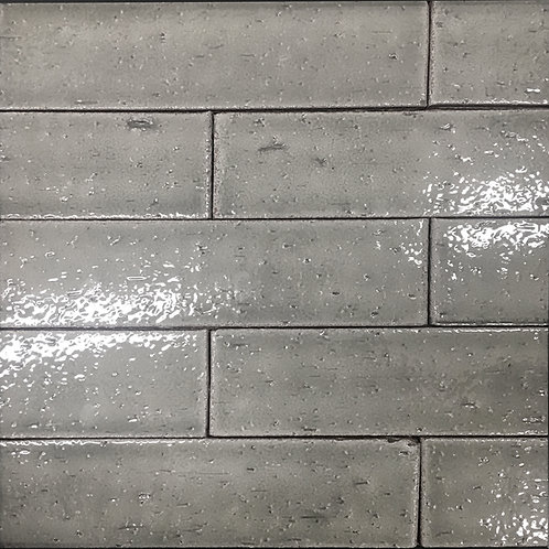 Craft Brick Asphalt, a grey ceramic tile that is rustic and full of character
