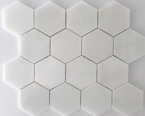 Glacier white, a natural stone tile in a hexagon shape is perfect for wall or floor installations
