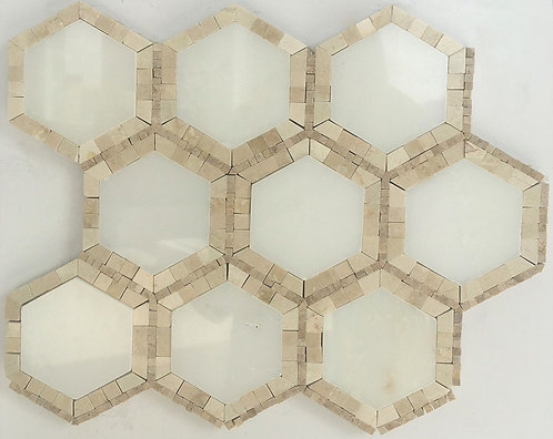 hexagons in white stone marble tile and mosaics in the spanish stone crema marfil make this pattern luxurious and beautiful