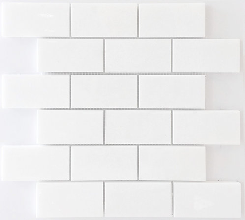 Bianco Thassos is a Greek marble seen here as a polished white subway tile
