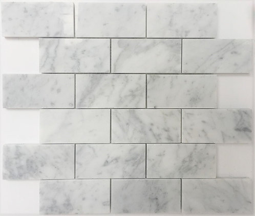 Bianco Carrara brick joint 2x4 is the stone that many use on their backsplash to add interest