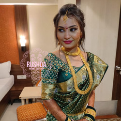 indian bride and bridal makeup artist in
