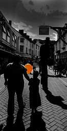 girl with orange balloon