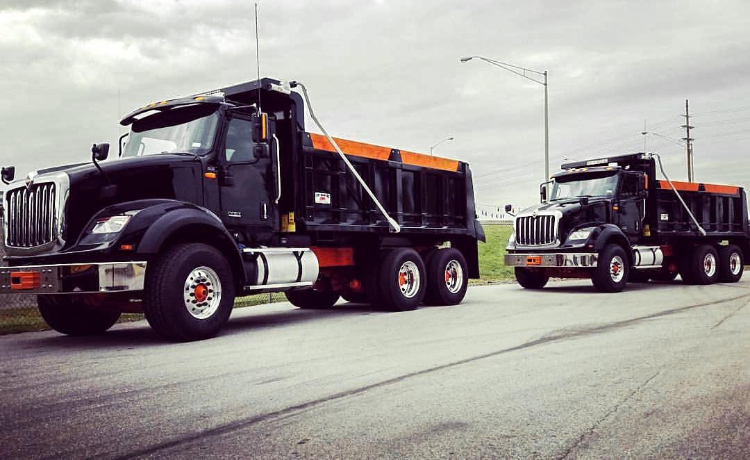 Two ADC Paving Trucks