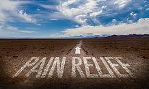Pain Relief written on desert road.jpg