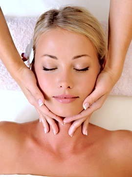 Facial massage for beautiful young woman