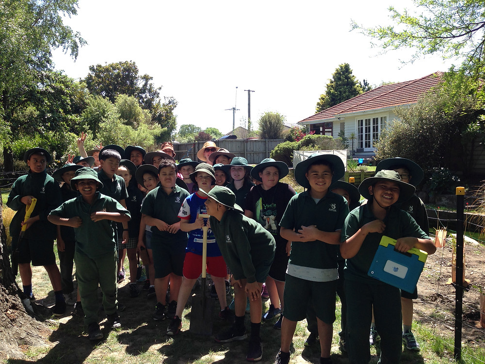 Hardworking Burnside Primary and Cobham Intermediate students at their planting day