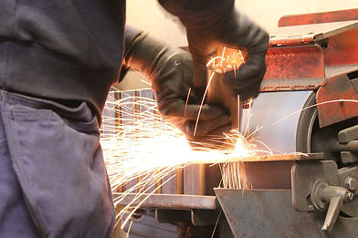1280px-Grinding_in_a_construction_firm.j