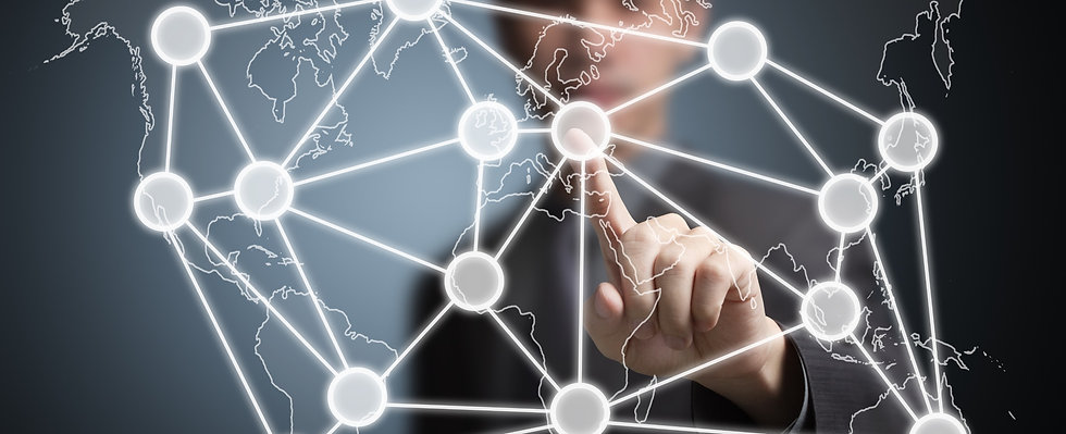 business man pointing at global network on world map_edited_edited.jpg