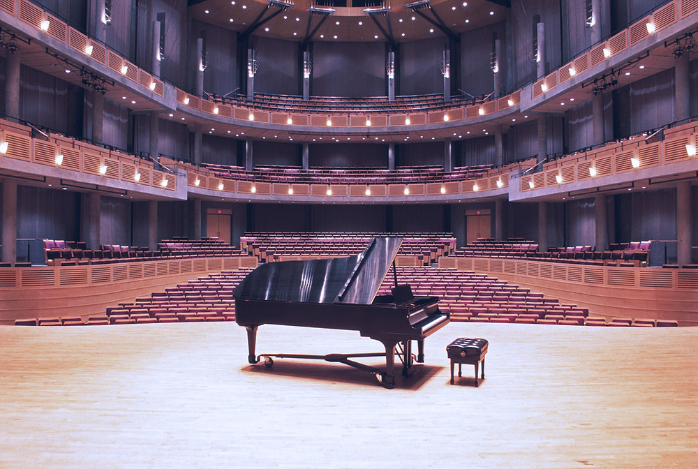 a grand piano in a concert hall