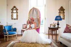Bride and flowergirl in ladies salon