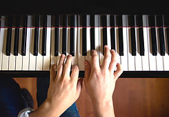 Close up of hands on a piano keyboard