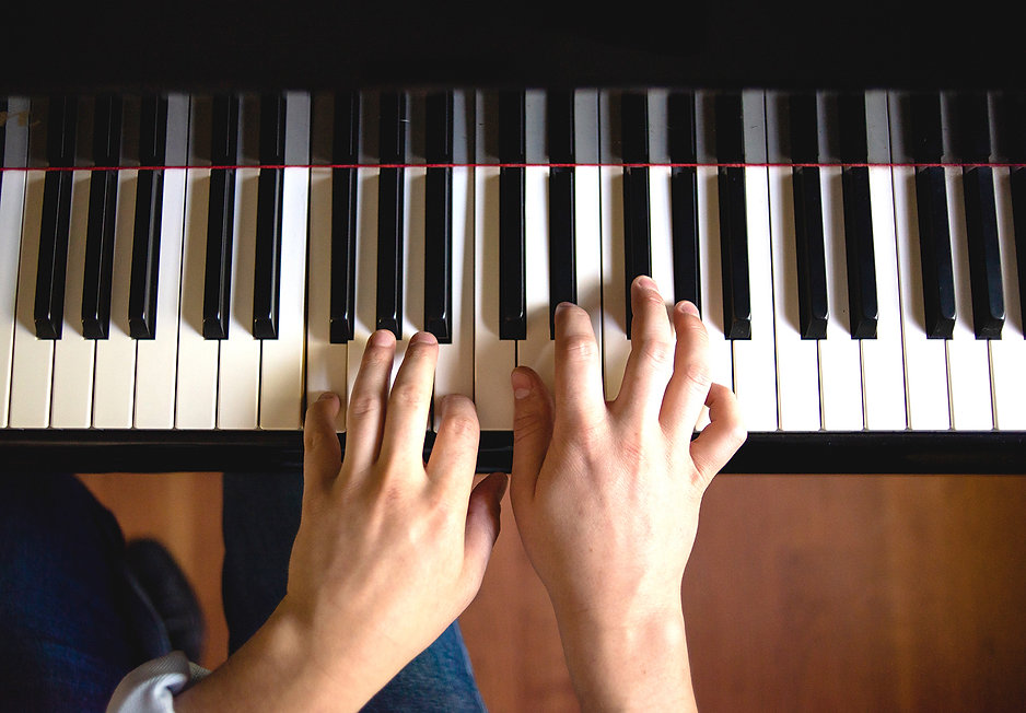 Close up of hand on a piano keyboard