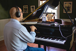 Dan Carunchio giving an online piano lesson to one of his students
