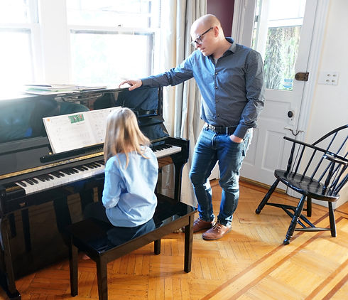 Dan Carunchio giving an in home piano lesson to a student
