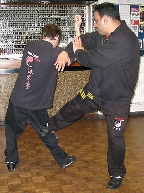 Low side knee kick