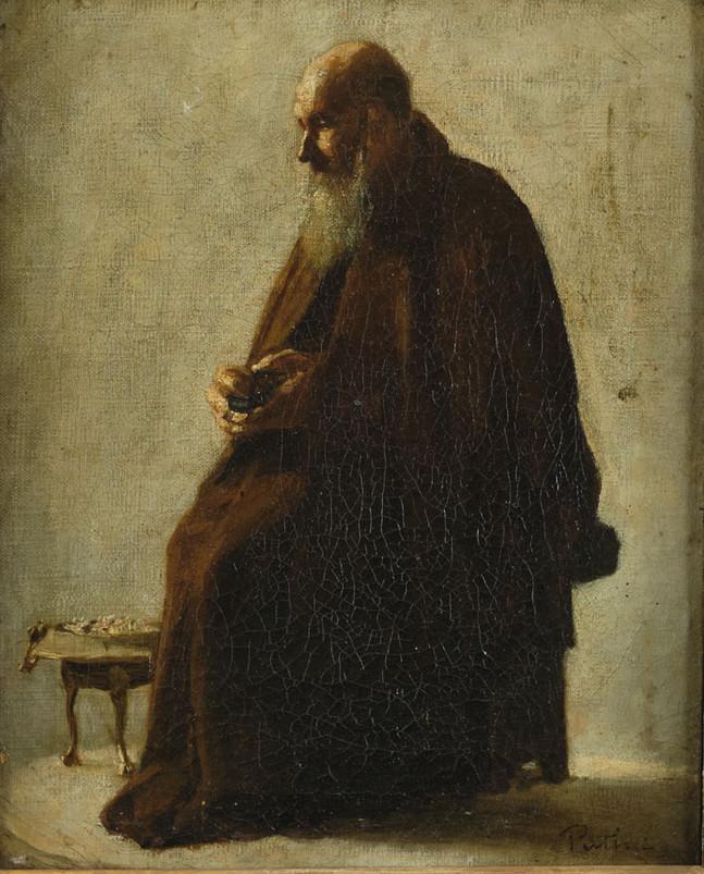 Frate cappuccino seduto con tabacchiera in mano