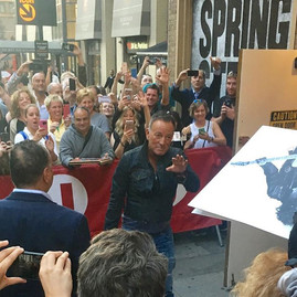 Bruce Springsteen waves to fans as he enters the Walter Kerr theater for the second night of previews for his show #springsteenonbroadway