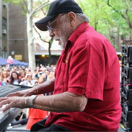 Latin Music Legend Eddie Palmieri thrills the crowds at Union Settlement 25 Annual  Ethnic Festival on 104th Street in NYC Saturday 20 May 2