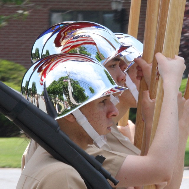 #WeHereLive Flags of PCTI ROTC Color Guard are seen reflected off of their helmets as they march in