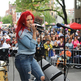 Tina Torres of Zon Del Barrio belts out a tune at Union Settlement 25 Annual  Ethnic Festival on 104th Street in NYC Saturday 20 May 2017