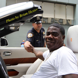 Tracy Morgan shakes hand with one of New Yorks Finest as he cruises Times Square in his white Rolls Royce